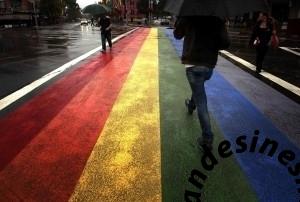people walk across a rainbow pedestrian crossing painted on sydney s oxford street 300x202 People walk across a rainbow pedestrian crossing painted on Sydneys Oxford street