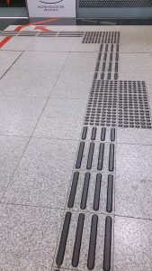 Tactile_paving_in_a_Mass_Rapid_Transit_station_in_Singapore_-_20131105